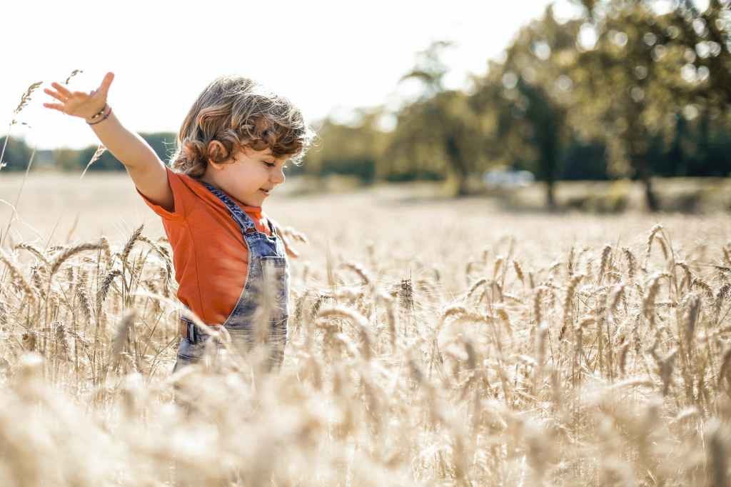 A child playing in a field is the perfect example of how boredom sparks creativity